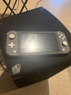 Nintendo Switch Lite Comes with Super Smash Bros and also 40 dollars worth of games for Sale in Fresno, CA