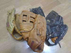 4 Right Handed Baseball Gloves And Assorted Balls for Sale in Beaverton, OR