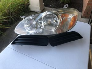 For Toyota Corolla 2003-2007 driver side headlight and fog lights cover for Sale in Reynoldsburg, OH