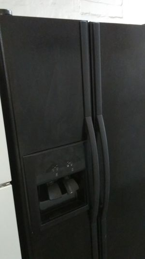 Black Whirlpool. Side by side refrigerators for Sale in Tampa, FL