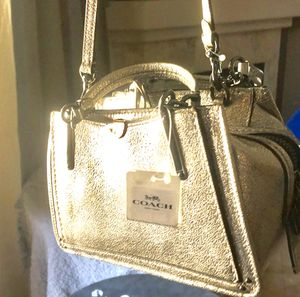 """Coach """"Dreamer 27"""" gold shimmer leather for Sale in Phoenix, AZ"""