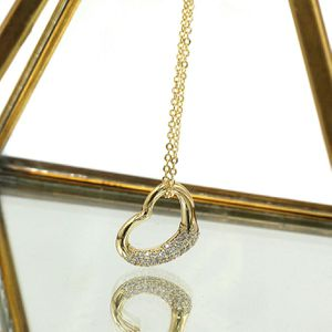 Gold cabinet micro crystal heart necklace for Sale in Atherton, CA