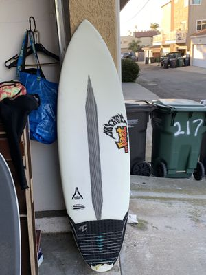 Los carbon wrap surfboard with fins for Sale in Huntington Beach, CA