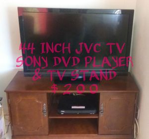 JVC 44 INCH T.V. SONY DVD PLAYER AND WOODEN TV STAND for Sale in Mesa, AZ