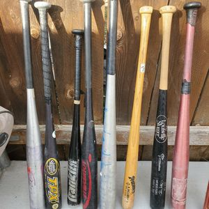 Baseball bats and gloves and balls for Sale in Santee, CA