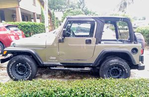 2004 automatic Jeep Wrangler SE (TJ) 2.4L scrambler for Sale in Orlando, FL