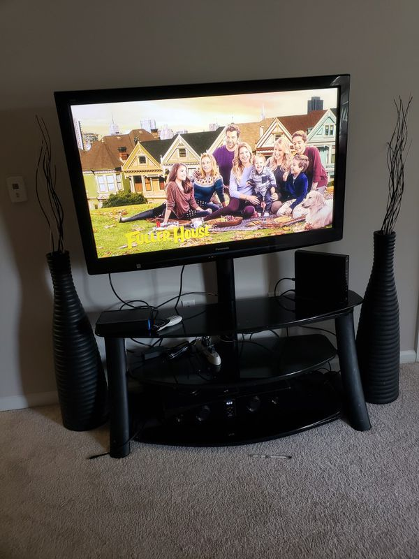 65inches tv with stand and side decorations