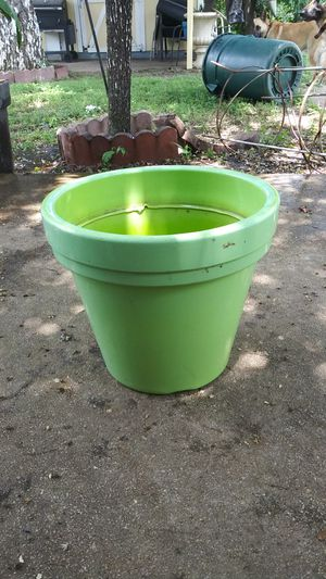 Small green plastic flower pot for Sale in San Antonio, TX