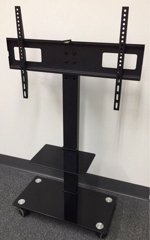 New in box 11x26x43 inches tall 32 to 65 inches tv television stand with wheels 90 lbs capacity for Sale in Whittier, CA
