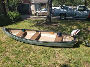13ft. Old Town canoe with 2hp Honda 4 stroke outboard for Sale in Spring, TX