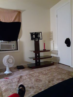 TV stand with mount on it glass shelfs for Sale in San Angelo, TX