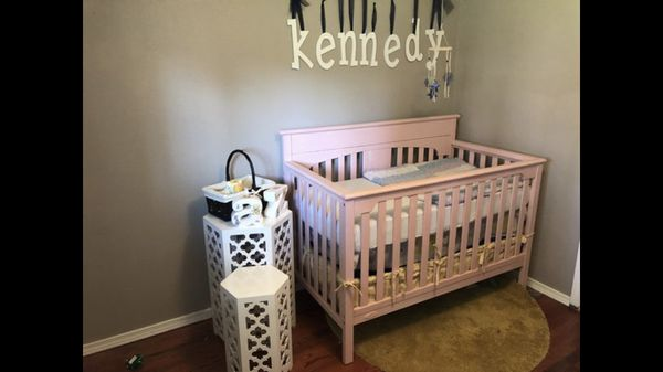 Pink changing table and crib