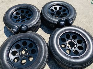 """18"""" used black rims and tires 8x165.1 Chevy gmc Dodge. 2657018 for Sale in Modesto, CA"""
