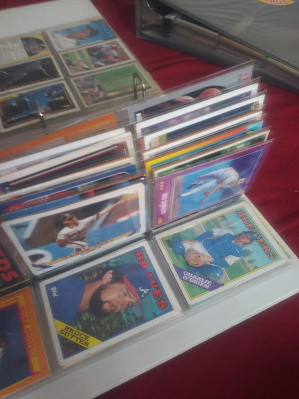 1000+ baseball, football, hockey, military cards.