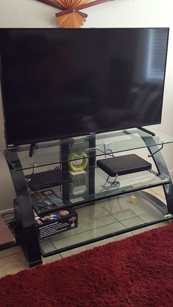 "TV stand - glass - holds up to 55"" tv"