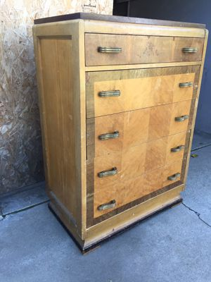 Solid wood tall dresser come with five drawers all drawers open fine. for Sale in Fresno, CA