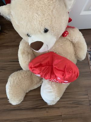 "plush tan teddy bear holding a red heart that says ""I Love You."" for Sale in Corona, CA"