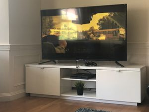48 inch tv with TV stand for Sale in Boston, MA