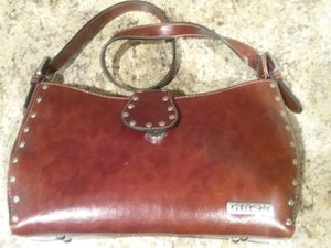 RINA RICH HAND BAG with a Gucci tag on outside of bag. for Sale in Phoenix, AZ