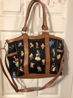 "Disney ""Carry The Magic"" Tote Brand with removable shoulder strap. Preowned very good condition for Sale in Artesia, CA"