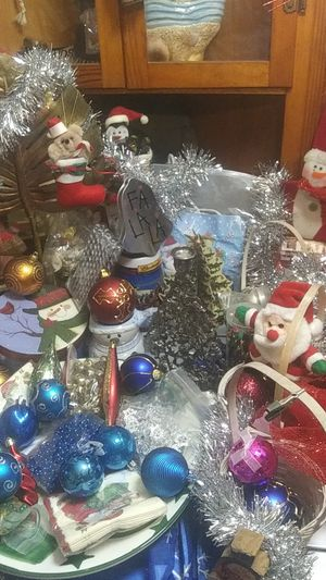 Christmas Decorations,lights,bulbs,tins,Garland,candle holders,stocking holders,Budweiser Stein,blowup reindeer head pieces.and ect. for Sale in Newark, OH