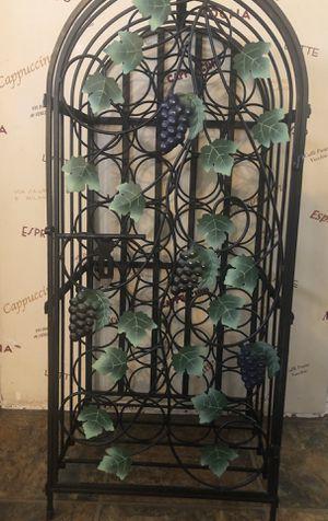 Wine rack, black, iron, holds 33 bottles. for Sale in Henderson, NV