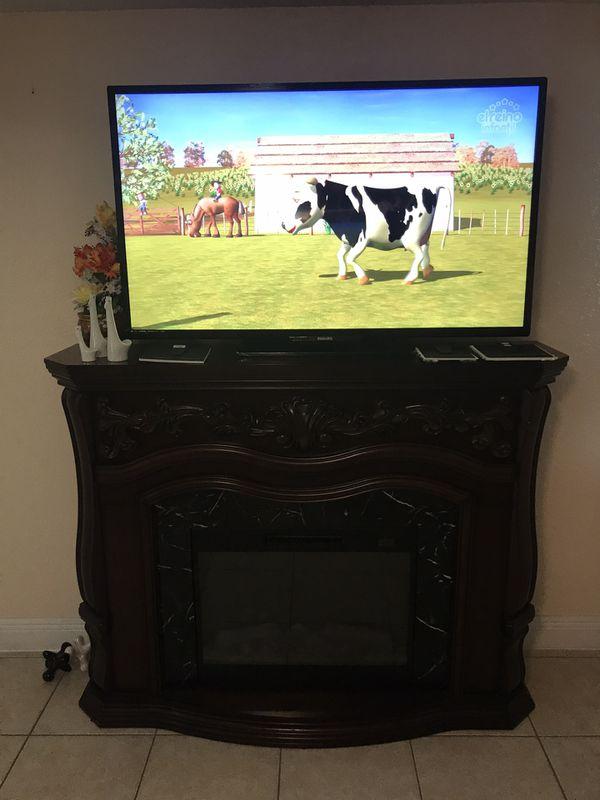 Tv 55 pulgadas y chimenea