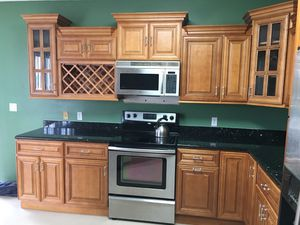 Toffee cabinet with emerald pearl granite for Sale in Fort Lauderdale, FL