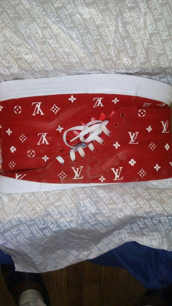 apair of sz 13 or 12 & ahalf Red LV vans wit supreme laces