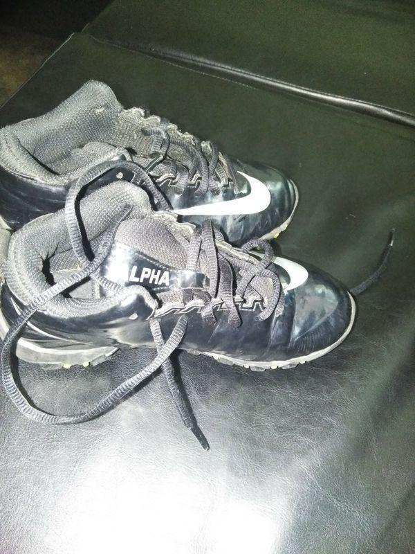Boys football cleats 1y $25