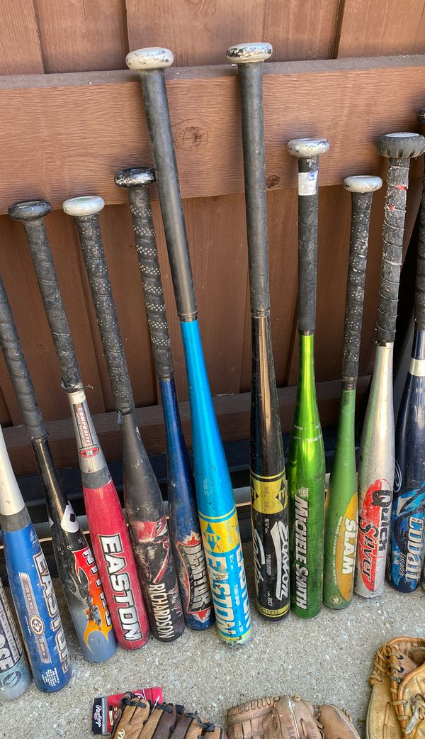 Baseball and softball lot. Bats and gloves. Will sell only together