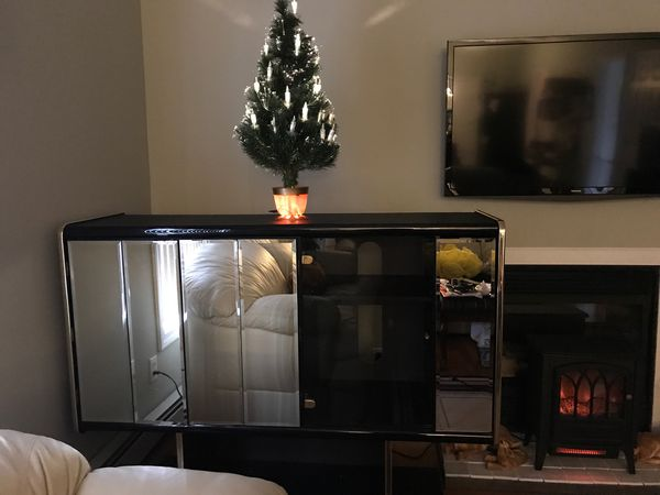 Entertainment Center Black with Beveled glass doors, shelf for TV and shelves for Stereo System and drawers for DVDs and storage . $300