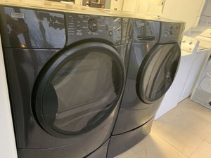 FRONT LOAD WASHER AND DRYER WITH PEDESTAL for Sale in Orlando, FL