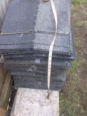 Pile of leftover roofing shingles ridge cap architectural shingles and starter for Sale in Sumner, WA