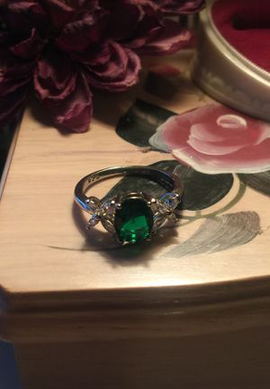 Beautiful Emerald with gorgeous little flowers on each side with channel set sapphires quality gem stones on stamped 925 sterling silver band size8 for Sale in Northfield, OH
