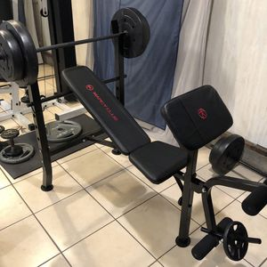 Gym Equipment Adjustable Bench press, barbell, leg developer and 100lbs of weight for Sale in Pico Rivera, CA