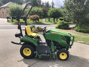 John Deere 1023E Sub-Compact Utility Tractor w/120R Loader Boom Assembly, 54 Inch Mid-Mount Side Discharge Mower, and Ballast Box for Sale in Olympia, WA