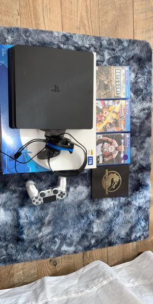 Playstation 4 with items for Sale in Vancouver, WA