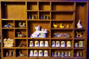 Shelf with various figurines for Sale in San Angelo, TX