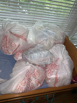 Baby diapers. size newborn and 1. A couple different brands including huggies and pampers for Sale in Glenwood, OR