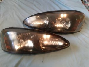 Pair of Pontiac 2004-2008 GRAND PRIX head light's with bulbs for Sale in El Mirage, AZ