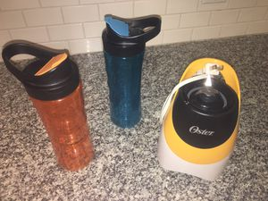 Oster On The Go Blender Orange with 2 On The Go Bottles Orange & Blue for Sale in Keller, TX