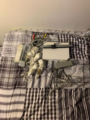 Wii with 1 controller, 4 nunchucks, 1 rubber with controller attachment. for Sale in Triangle, VA