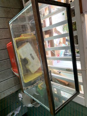 Aquarium with aquarium stand. Was used for build a dragon but we upgraded to a 55 gallon tank. Not sure how many gallons this one is but it comes wit for Sale in Sandy, OR