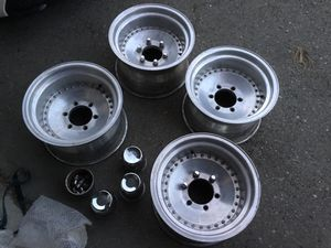 15x10 Aluminum 6 Lug Wheels with Dust covers and Chrome Lug nuts ...4wheels 4caps and lug nuts... 6 Lug 5.5 inch or 139.7mm Medium offset. for Sale in San Jose, CA