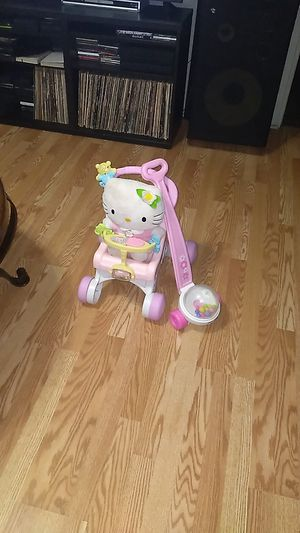 Nice little toddler strollerwith hello kitty and Push Popper Toy. $10 For all firm for Sale in Lancaster, TX