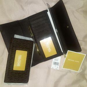 Michael Kors MK Signature Leather Checkbook wallet for Sale in Midlothian, VA