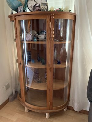 Antique Curio Cabinet with curved Glass And Skeleton Key for Sale in Manteca, CA