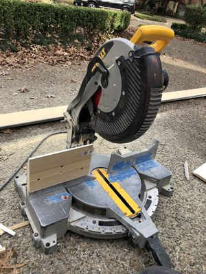 "Dewalt 12"" miter saw works find needs left side guide I custome made one blade not included reason selling it bought new one!!!!! for Sale in Garland, TX"