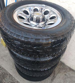 $$$$Chevy Silverado/Tahoe/Suburban/GMC rims and tires ...245/70/17 for Sale in San Bernardino, CA
